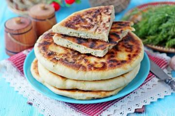 Khachapuri with cottage cheese and cheese